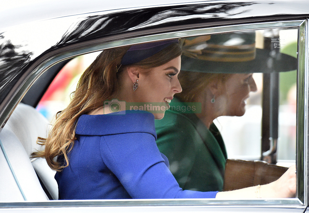 Princess Beatrice and her mother Sarah Ferguson arrive at Cambridge Gate in Windsor for the wedding of Princess Eugenie to Jack Brooksbank at St George's Chapel in Windsor Castle.