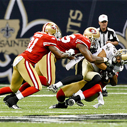 August 12, 2011; New Orleans, LA, USA; New Orleans Saints wide receiver Lance Moore (16) is tackles by San Francisco 49ers defenders during the first half of a preseason game at the Louisiana Superdome. Mandatory Credit: Derick E. Hingle