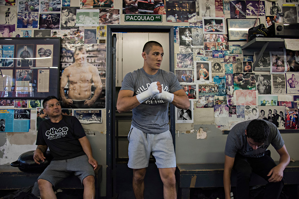 June 8, 2017 / Hollywood, Calif.<br /> <br /> Coming straight from a media event at the Viacom Headquarters hyping his much-anticipated MMA debut, Aaron Pico, 20, quickly changed out of his suit and exits the locker room at Wild Card Boxing Club, wrapped and ready to spar with his long-time boxing coach Dominic Viloria, seated at left. (Melissa Lyttle for ESPN)