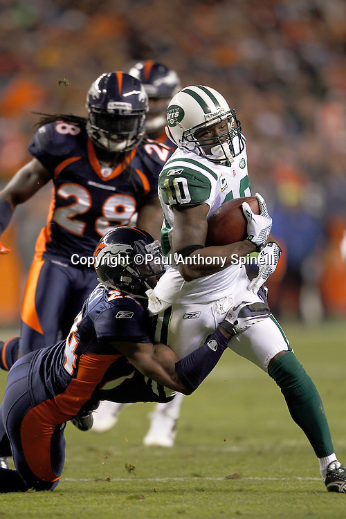 New York Jets wide receiver Santonio Holmes (10) catches a second quarter pass in the red zone while getting tackled by Denver Broncos cornerback Champ Bailey (24) during the NFL week 11 football game against the Denver Broncos on Thursday, November 17, 2011 in Denver, Colorado. The Broncos won the game 17-13. ©Paul Anthony Spinelli