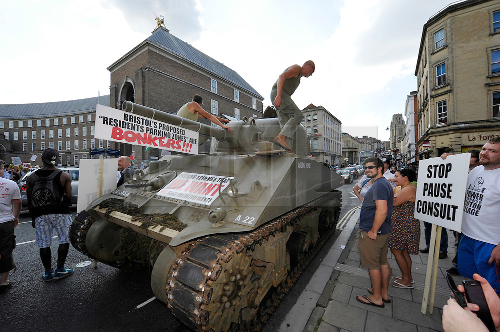 © Licensed to London News Pictures. 22/07/2014; Bristol, UK.  A WW2 Sherman tank is used in a protest against Residents Parking Zones (RPZ) in Bristol, before a meeting of the City Council where the elected Mayor George Ferguson faces a debate of no confidence in his handling of RPZ.  The protest was partly organised by Tony Miles aka Smiley Miley from the Radio One Roadshow.<br /> Photo credit: Simon Chapman/LNP