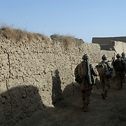 Canadian soldiers from the Van Doos B Company move past compounds after searching for insurgents in a small village in the Sangasar region during the Canadian lead Operation Tashwish Mekawah in a joint operation with Afghan National Army (ANA) soldiers in the Sangasar and Howz-E-Madad area in the volatile Zhari District in Afghanistan.