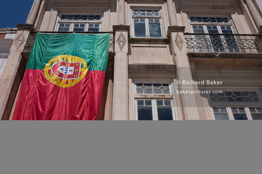 Days after Portugal's historic football victory over France in the final of Euro 2016, the Portuguese national flag still hangs from an apartment balcony, on 16th July, at Alcobaca, Portugal. (Photo by Richard Baker / In Pictures via Getty Images)