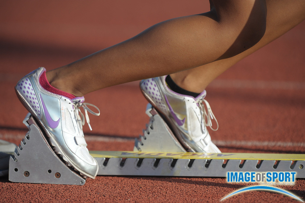 Apr 7, 2012; Arcadia, CA, USA; General view of the Nike track spikes of Laura Stokes of Vista Murrieta in the starting blocks of the girls 4 x 100m relay in the Arcadia Invitational at Arcadia High.