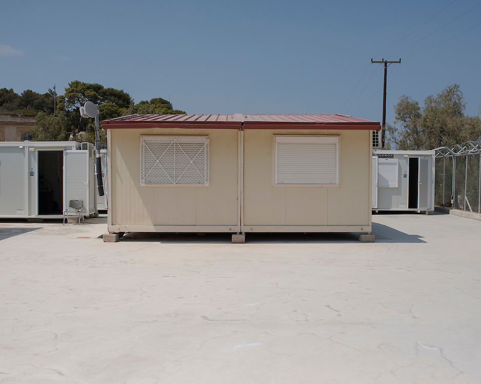 A typical prefabricated house in the First Reception Centre (Hot-Spot) of Leros, Greece.<br /> <br /> The Hot Spot in Lepida opened on the 26th of February 2016 in the grounds of the former Lepida psychiatric hospital.  At the beginning it served as a registration camp for refugees and migrants who were travelling to Europe through Greece but since the closure of the borders in March 2016 it serves as a permanent camp. People are allowed to go out, they have three meals a day, the prefabricated huts have a bathroom and are air-conditioned and compering to other refugee camps in Greece the conditions are bearable.