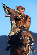 An eagle hunter prepares to demonstrate his eagle for spectators at the annual Eagle Hunting Festival which celebrates Kazakh culture, Bayan Olgi, Mongolia, Oct 2, 2004.  Kazakhs have hunted with eagles for centuries.  The Eagle Hunting Festival has revived Kazakh culture which was surpressed under Soviet rule.