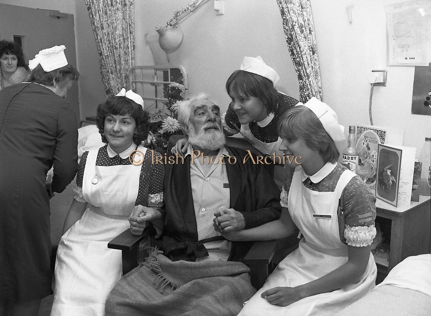 Noel Purcell Celebrates His 81st Birthday.23.12.1981..12.23.1981..23rd December 1981..Noel Purcell celebrates his 81st birthday in the Adelaide Hospital.Noel receives great care and attention from the matron and nurses