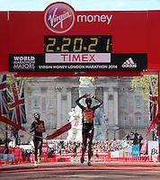 Women's race Edna Kiplagat of Kenya crosses the finishing line on The Mall in a winning time of 02:20:21 at The Virgin Money London Marathon 2014 on Sunday 13 April 2014<br /> Photo: Roger Allan/Virgin Money London Marathon<br /> media@london-marathon.co.uk