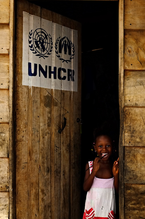 AVEPOZO, TOGO  13-05-04   -  A girl stands in a doorway of a UNHCR shelter in the Avepozo Refugee Camp in Avepozo, Togo. The camp is for refugees from Cote d'Ivoire who fled violence in 2011.  Photo by Daniel Hayduk