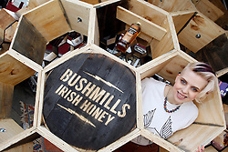 Repro Free Dublin, 5th April 2013:  Pictured celebrating the launch of Bushmills Irish Honey, the latest addition to the Bushmills collection of premium blends and single malts is Celina Murphy, Bushmills Honey Ambassador. Bushmills commissioned some good friends who are artisans to make the launch memorable by handcrafting a 14 square foot Honey Hive. 2500 screws, 250 hours, 200 hexes and 10 whiskey casks later, the handcrafted wooden hive played host to a surprise live gig in Temple Bar Square, Dublin from acclaimed Northern Irish artist Rams' Pocket Radio, AKA Peter McCauley and Fiona O'Kane from Runaway Go. The celebration will continue later that evening with a launch event gig in Whelan's where Rams' Pocket Radio will headline along with other indie music artists, Runaway Go and Verse Chorus Verse. For more information about Bushmills Irish Honey and to find cocktail recipes, visit the website: www.bushmills.com or Facebook: facebook.com/bushmills1608Enjoy BUSHMILLS Sensibly Visit drinkaware.ie The BUSHMILLS word, the Pot Still device and other associated logos are trade marks. © The Old Bushmills Distillery Co. Limited 2013. Picture Andres Poveda