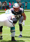 Sep 15, 2019; Miami Gardens, FL, USA; New England Patriots defensive end Chase Winovich (50) gets ready at the line of scrimmage during an NFL game against the Miami Dolphins at Hard Rock Stadium in Miami Gardens, FL. The Patriots beat the Dolphins 43-0. (Steve Jacobson/Image of Sport)
