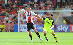 Kevin Dawson of Cheltenham Town competes with Craig Woodman of Exeter City for the highball -Mandatory by-line: Nizaam Jones/JMP - 26/08/2017 - FOOTBALL - LCI Rail Stadium - Cheltenham, England - Cheltenham Town v Exeter City - Sky Bet League Two