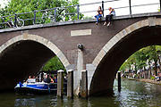 Boating on the Oudegracht canal, Utrecht, Netherlands
