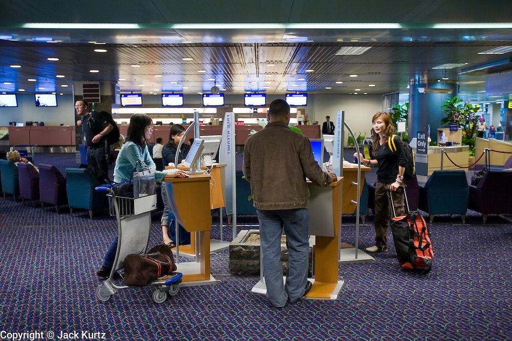 08 MARCH 2006 - People use internet kiosks in Changi Airport in Singapore. PHOTO BY JACK KURTZ