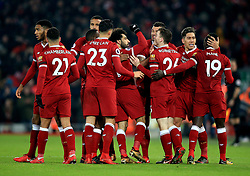Liverpool's Mohamed Salah (centre) celebrates scoring his side's fourth goal of the game during the Premier League match at Anfield, Liverpool.