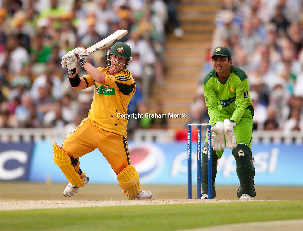 David Warner bats, watched by wicket keeper Kamran Akmal during the first International T20 match between Australia and Pakistan at Edgbaston, Birmingham.  Photo: Graham Morris (Tel: +44(0)20 8969 4192 Email: sales@cricketpix.com) 05/07/10