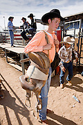 02 NOVEMBER, 2008 -- PHOENIX, AZ:  Saddle bronc riders leave the chute area after competing at the Arizona High School Rodeo at the Arizona State Fair in Phoenix. Teams from across the state participate. The Arizona High School Rodeo Association sponsors a full season of high school rodeo that culminate in a championship rodeo in June.  PHOTO BY JACK KURTZ
