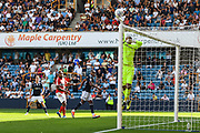 Millwall Goalkeeper Jordan Archer (1) tips the ball over the bar during the EFL Sky Bet Championship match between Millwall and Middlesbrough at The Den, London, England on 4 August 2018. Picture by Stephen Wright.