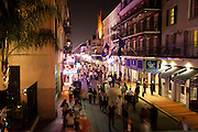 Bourbon Street view from Arnaud's Restaurant balcony includes Rick's Cabaret and the Royal Sonesta Hotel