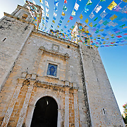 Pennants fly in the breeze at the Cathedral of Nuestra Señora de la Asunción in Valladolid, Yucatan, Mexico.