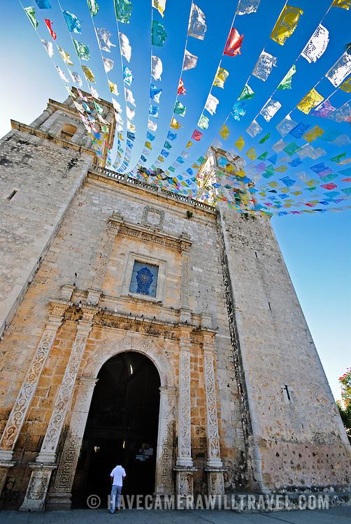 Pennants fly in the breeze at the Cathedral of Nuestra Señora de la Asunción in Valladolid, Yucatan, Mexico.
