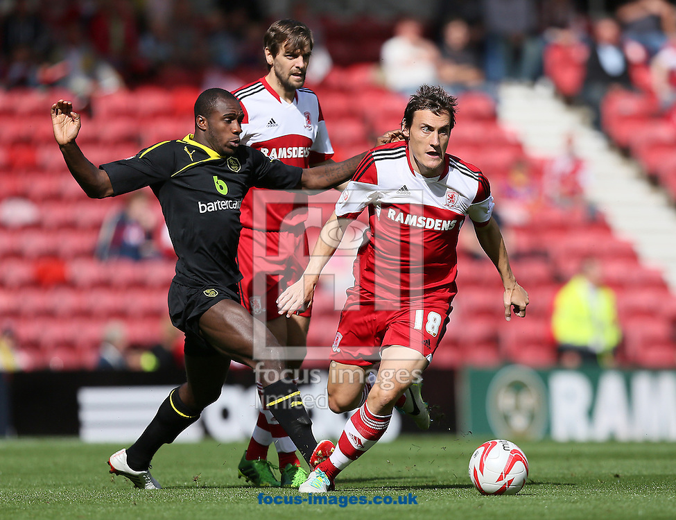 Picture by Paul Gaythorpe/Focus Images Ltd +447771 871632<br /> 31/08/2013<br /> Michail Antonio of Sheffield Wednesday and Dean Whitehead of Middlesbrough during the Sky Bet Championship match at the Riverside Stadium, Middlesbrough.