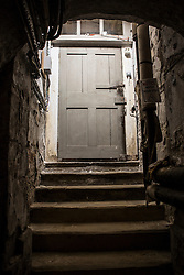 © Licensed to London News Pictures. 23/06/2015. Leeds, UK. Rarely seen hidden Tudor tunnels & cellars of Temple Newsam house in Yorkshire. Picture shows a hidden stairwell behind a door underneath the house. Temple Newsam is famous as the birth place of Lord Darnley, notorious husband of Mary Queen of Scots. The Tudor-Jacobean mansion is set in 1,500 acres with grounds landscaped by Capability Brown. Photo credit : Andrew McCaren/LNP
