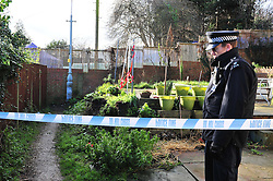 © London News Pictures. 05/01/2016. A police officer guards the rear of the home of former Eastenders actress Sian Blake in Erith, Kent, which has been turned into a crime scene today (05/01/2016). Sian Blake and her two children have been missing for more than three weeks. Her partner has been described as a 'high-risk missing person'. Photo credit: Grant Falvey/LNP