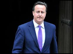 The Prime Minister David Cameron leaves the Leveson Inquiry at the High Court, London, after giving evidence to the inquiry, Thursday June 14, 2012. Photo by Andrew Parsons/i-Images..All Rights Reserved ©Andrew Parsons/i-Images .See Special Instructions