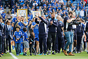 Leicester City squad and staff including Leicester City manager Craig Shakespeare parade around the pitch after during the Premier League match between Leicester City and Bournemouth at the King Power Stadium, Leicester, England on 21 May 2017. Photo by Richard Holmes.