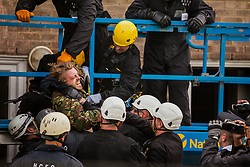 Bailiffs remove a housing activist from a cherry picker used for evictions from the Sweets Way housing estate on 23rd September 2015 in London, United Kingdom. A group of housing activists calling for better social housing provision in London had occupied some of the properties on the 142-home estate in Whetstone, in some cases refurbishing properties intentionally destroyed by the legal owners following eviction of the original residents, in order to try to prevent the eviction of the last resident on the estate and the planned demolition and redevelopment of the entire estate by Barnet Council and Annington Property Ltd.