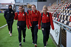 NEWPORT, WALES - Thursday, April 4, 2019: Wales' Megan Wynne (L),, Anna Filbey (C) and Charlie Estcourt arrive before an International Friendly match between Wales and Czech Republic at Rodney Parade. (Pic by David Rawcliffe/Propaganda)