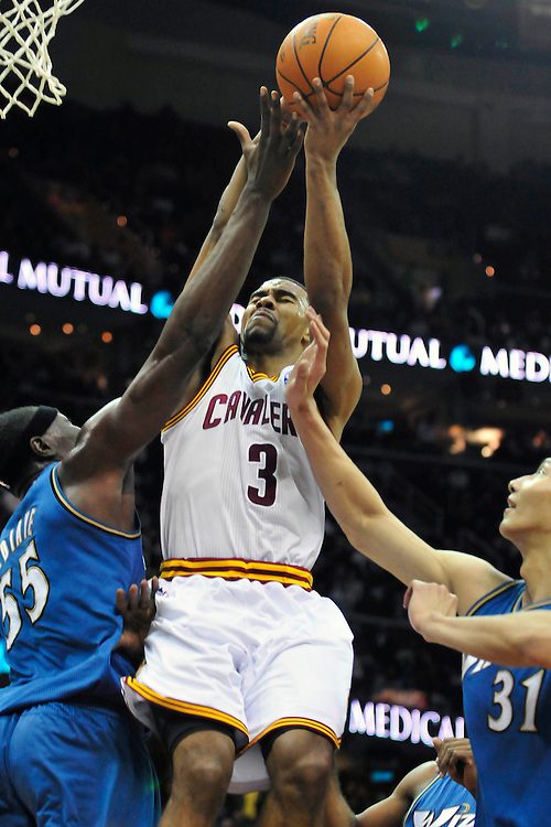 April 13, 2011; Cleveland, OH, USA; Cleveland Cavaliers point guard Ramon Sessions (3) shoots over Washington Wizards center Hamady Ndiaye (55) and power forward Yi Jianlian (31) during the second quarter at Quicken Loans Arena. Mandatory Credit: Jason Miller-US PRESSWIRE