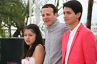 Actress Andrea Vergara, director Amat Escalante and actor Armando Espitia at the Heli film photocall at the Cannes Film Festival 16th May 2013