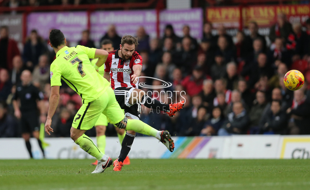 Brentford midfielder Alan Judge shoots during the Sky Bet Championship match between Brentford and Brighton and Hove Albion at Griffin Park, London, England on 26 December 2015.
