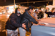 "05 FEBRUARY 2005 - NOGALES, SONORA, MEXICO: Police in Nogales, Sonora, Mexico search suspected gang members during a sweep in Nogales. Members of ""Grupo Operativos"" a special operations unit of the Nogales, Sonora, Mexico, police department, on patrol in Nogales, Saturday night, Feb. 5. The Operativos specialize in anti-gang enforcement and drug interdiction missions. In recent months they have stepped up patrol activity in Nogales communities near the border. In January 2005, the US Department of State has issued a travel advisory advising US citizens to avoid travel along the US Mexican border because of increased violence, including the kidnapping of US citizens, in border communities. Most of the violence has been linked to the drug cartels, who are increasingly powerful in Mexico. The Operativos also patrol the districts of Nogales frequented by US tourists in an effort to prevent crime directed against US citizens.   PHOTO BY JACK KURTZ"