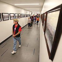 Lewis Brown, of Starkville, looks at photos as he walks down the main hallway of the renovated Starkville Police Department as part of the grand opening ceremony Friday morning in Starkville.