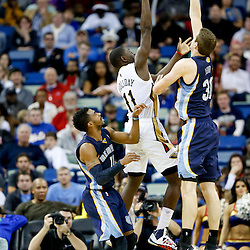 Dec 13, 2013; New Orleans, LA, USA; New Orleans Pelicans point guard Jrue Holiday (11) shoots over Memphis Grizzlies power forward Jon Leuer (30) during the second half of a game at New Orleans Arena. The Pelicans defeated the Grizzlies 104-98. Mandatory Credit: Derick E. Hingle-USA TODAY Sports