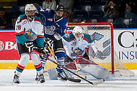 KELOWNA, CANADA - SEPTEMBER 3: Eric Florchuk #14 of Victoria Royals is checked by Kelvin Hair #28 in front of the net of Brodan Salmond #31 of Kelowna Rockets during first period on September 3, 2016 at Prospera Place in Kelowna, British Columbia, Canada.  (Photo by Marissa Baecker/Shoot the Breeze)  *** Local Caption *** Eric Florchuk; Brodan Salmond; Kelvin Hair;