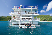 Snorkellers are taught the finer points of scuba diving before taking the plunge on the Great Barrier Reef. They are sitting on the back of a Coral Princess cruise ship on route from Townsville to Cairns in far north Queensland.