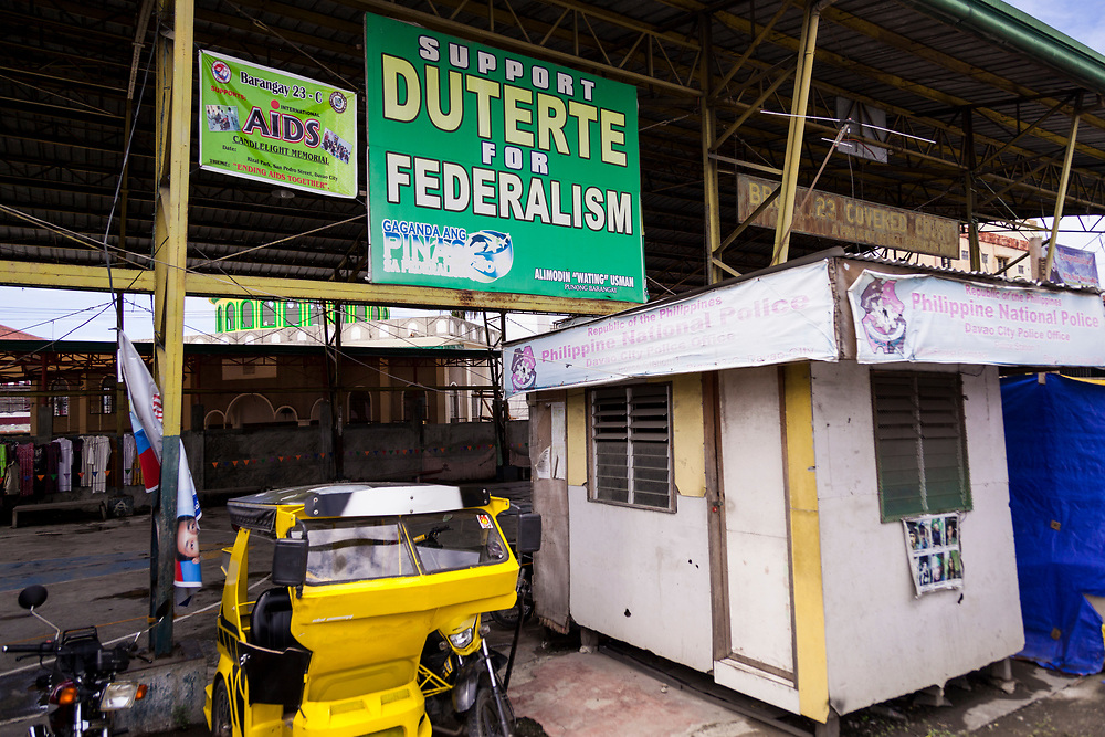 Davao City, Mindanao, Philippines - JUNE 24: A posted in support of Duterte's Federalism is seen in front of the entrance of Mini Forest Barangay 23C.  Currently, over 570 families and roughly 2500 evacuees from Marawi reside in the Mini Forest.