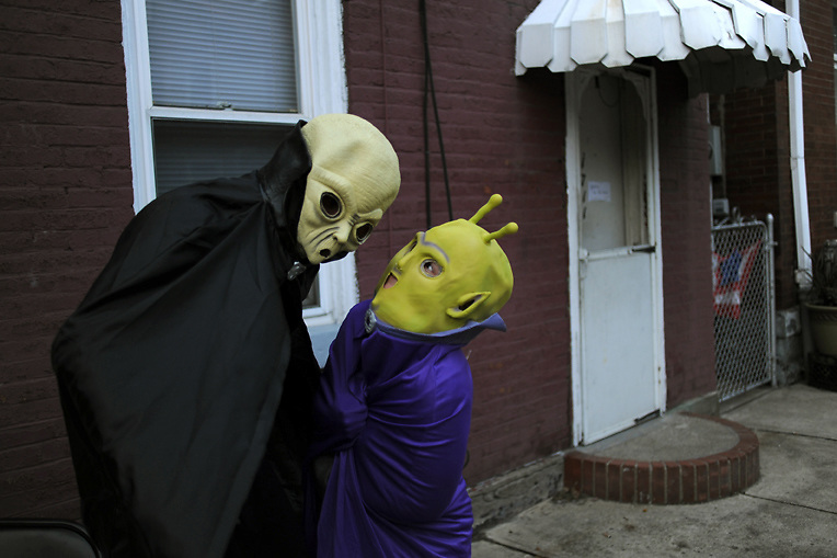 Aliens wait for trick or treaters Halloween evening on the South Side in Pittsburgh