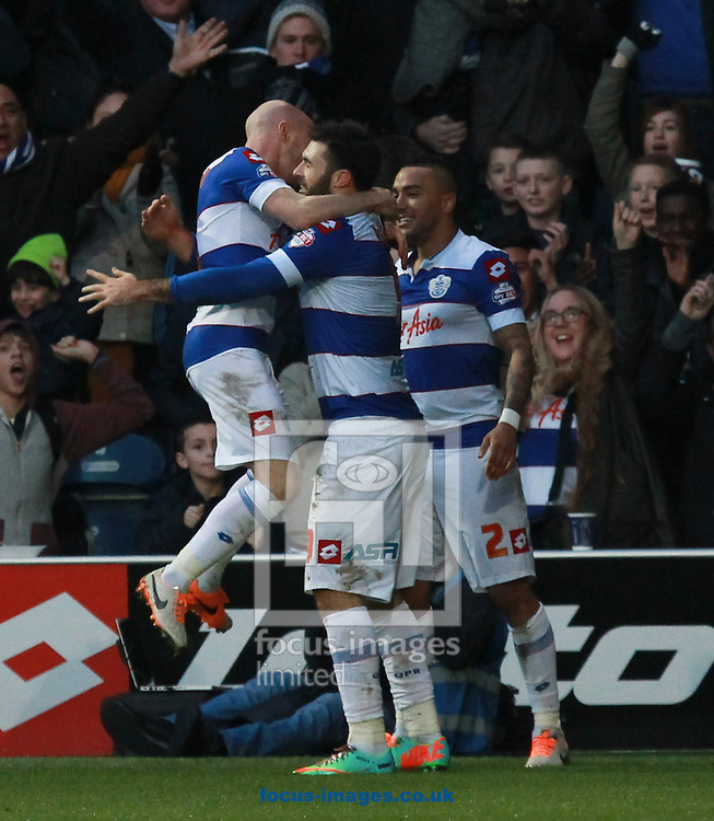 Picture by John Rainford/Focus Images Ltd +44 7506 538356<br /> 18/01/2014<br /> Charlie Austin of Queens Park Rangers celebrates after opening the scoring against Huddersfield Town during the Sky Bet Championship match at the Loftus Road Stadium, London.