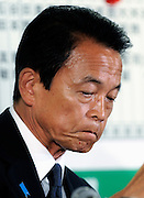 Taro Aso, president of Japan's ruling Liberal Democratic Party and prime minister of Japan, looks dejected after his party's poor showing in Japan's elections at the LDP headquarters in Tokyo, Japan on Sunday 30 August 2009.
