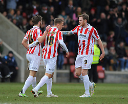 Cheltenham Town's Denny Johnstone celebrates his goal with team mates.  - Photo mandatory by-line: Nizaam Jones - Mobile: 07966 386802 - 14/02/2015 - SPORT - Football - Cheltenham - Whaddon Road - Cheltenham Town v Bury - Sky Bet League Two