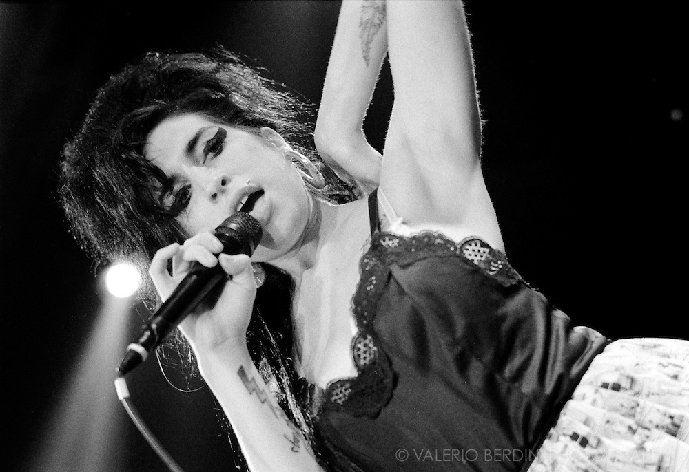 Amy Winehouse live in concert at the Cambridge Junction on 19 November 2006. Photographed on b&w 35mm film
