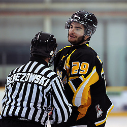 LINDSAY, ON - Feb 7 : Ontario Junior Hockey League Game Action between the Lindsay Muskies and the Aurora Tigers , Linesman Sheldon Berezowki with Adam DiBrina #29 of the Aurora Tigers Hockey Club during first period game action.<br /> (Photo by Andy Corneau / OJHL Images)