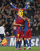 FC Barcelona's Leo Messi (t), Sergio Busquets (d) and David Villa celebrate goal during UEFA Champions League match.March 8,2011.