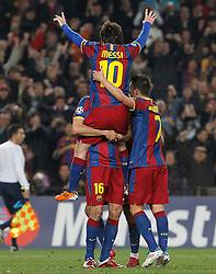 FC Barcelona's Leo Messi (t), Sergio Busquets (d) and David Villa celebrate goal during UEFA Champions League match.March 8,2011.