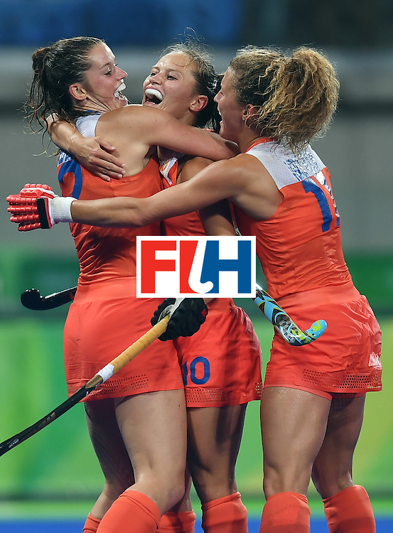 Netherland's Kelly Jonker (C) is congratulated by teammates after scoring a goal during the women's quarterfinal field hockey Netherlands vs Argentina match of the Rio 2016 Olympics Games at the Olympic Hockey Centre in Rio de Janeiro on August 15, 2016.  / AFP / MANAN VATSYAYANA        (Photo credit should read MANAN VATSYAYANA/AFP/Getty Images)